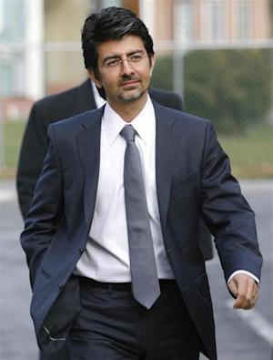 EBay founder and chairman Pierre Omidyar enters the courthouse to testify in the eBay versus Craigslist trial at the Chancery Court in Georgetown, Delaware