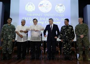 U.S. and Philippine officials, from left, Vice-Admiral …