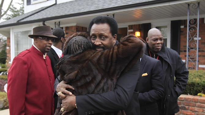 CORRECTS DEATH TO LAST MONTH, NOT THIS MONTH - Thomas Hearns receives a hug outside the home of the late boxing trainer Emanuel Steward in Detroit, Tuesday, Nov. 13, 2012 Hearns was in the Motor City to attend the funeral service for Steward, who died last month. (AP Photo/Carlos Osorio)