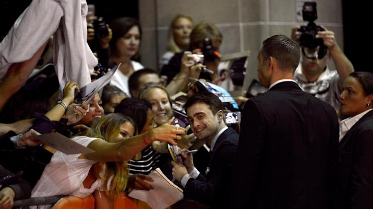 "Daniel Radcliffe signs autographs as he arrives at the premiere of ""The F Word"" on day 3 of the Toronto International Film Festival at the Ryerson Theatre on Saturday, Sept. 7, 2013, in Toronto. (Photo by Chris Pizzello/Invision/AP)"