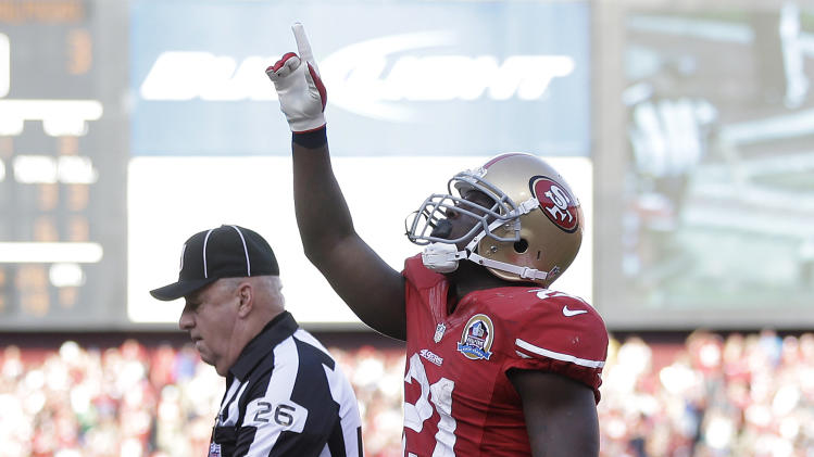 San Francisco 49ers running back Frank Gore celebrates after scoring a touchdown on a one-yard run during the third quarter of an NFL football game against the Miami Dolphins in San Francisco, Sunday, Dec. 9, 2012. (AP Photo/Marcio Jose Sanchez)