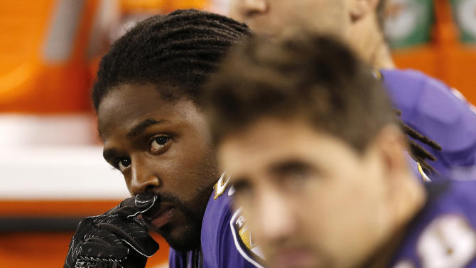 Baltimore Ravens wide receiver Torrey Smith, left, looks on from the sideline during the second half of an NFL football game against the New England Patriots in Baltimore, Sunday, Sept. 23, 2012. Smith's younger brother was killed late Saturday in a motorcycle accident in northeast Virginia. (AP Photo/Patrick Semansky)