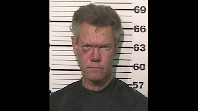 This photo provided by the Grayson County, Texas, Sheriff's Office shows Country singer Randy Travis who has been charged with driving while intoxicated. Authorities say Travis was being jailed without bond Wednesday, Aug. 8, 2012, pending an appearance before a judge in Sherman, Texas, about 60 miles north of Dallas. (AP Photo/Grayson County Sheriff's Office)