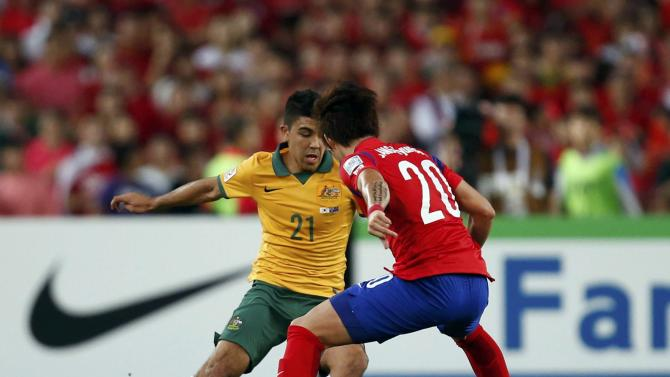 Australia's Massimo Luongo fights for the ball with South Korea's Jang Hyun-soo during their Asian Cup final soccer match at the Stadium Australia in Sydney