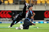 New Zealand's Grant Elliott (right) and Brendon McCullum fall over each other trying to take a catch from England's Michael Lumb during their Twenty20 match at the Westpac Stadium in Wellington on February 15, 2013. Alex Hales produced a batting masterclass as England dominated New Zealand with both bat and ball to race to a 10-wicket win in the T20 series decider in Wellington