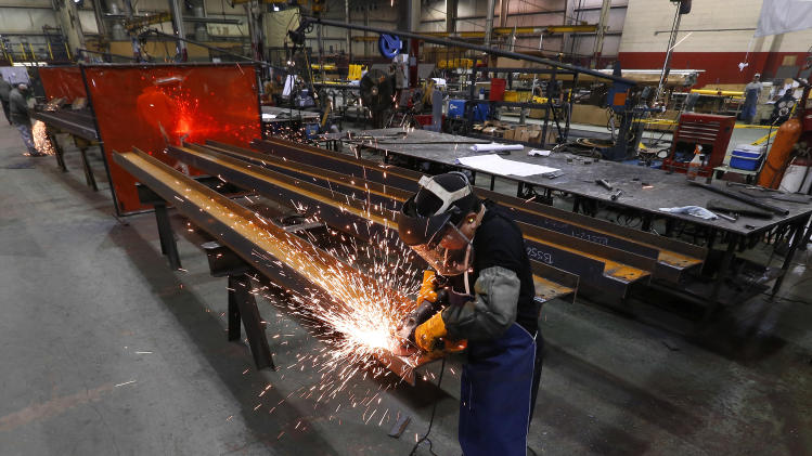 US manufacturing boosted by orders and stockpiles