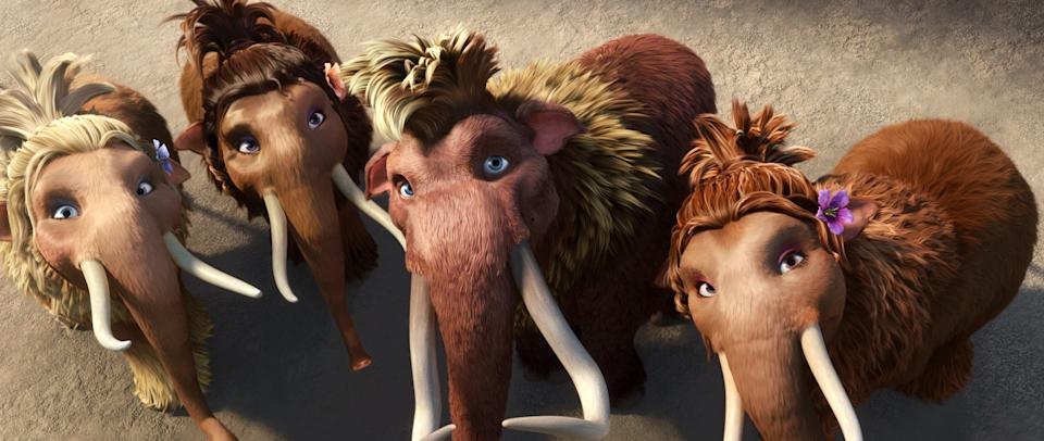 "This image released by 20th Century Fox shows teenage wooly mammoths, from left, Katie, voiced by Heather Morris, Meghan, voiced by Alexandra Romano, Ethan, voiced by Drake and Steffie, voiced by Nicki Minaj in a scene from the animated film, ""Ice Age: Continental Drift."" (AP Photo/20th Century Fox)"