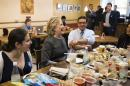 Democratic presidential candidate Hillary Clinton sits with contest winners at the Works Bakery Cafe in Durham, N.H., Wednesday, Sept. 28, 2016. (AP Photo/Matt Rourke)