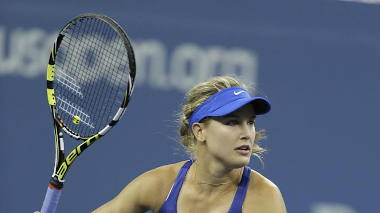 Eugenie Bouchard, of Canada, runs down a shot buy Sorana Cirstea, of Romania, during the second round of the 2014 U.S. Open tennis tournament Thursday, Aug. 28, 2014, in New York. (AP Photo/Darron Cummings)