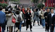 This file photo shows pedestrians crossing a street in Taipei, in 2011. Taiwan's economy shrank by 0.16 percent in the second quarter from a year ago, the first contraction in nearly three years, as the island was hit by weak export markets, according to the government