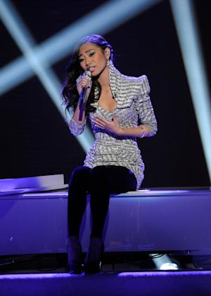 """In this April 11, 2012 photo released by Fox, Jessica Sanchez performs on the singing competition series """"American Idol,"""" in Los Angeles. (AP Photo/Fox, Michael Becker)"""