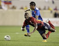 United States midfielder Maurice Edu (8) goes down on a play against Ecuador forward Michael Arroyo in the first half of an international soccer friendly game, Tuesday, Oct. 11, 2011, in Harrison, N.J. (AP Photo/Julio Cortez)