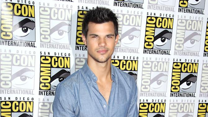 """Actor Taylor Lautner arrives at the """"The Twilight Saga: Breaking Dawn - Part 2"""" press line during Comic-Con, Thursday, July 12, 2012, in San Diego. (Photo by Matt Sayles/Invision/AP)"""