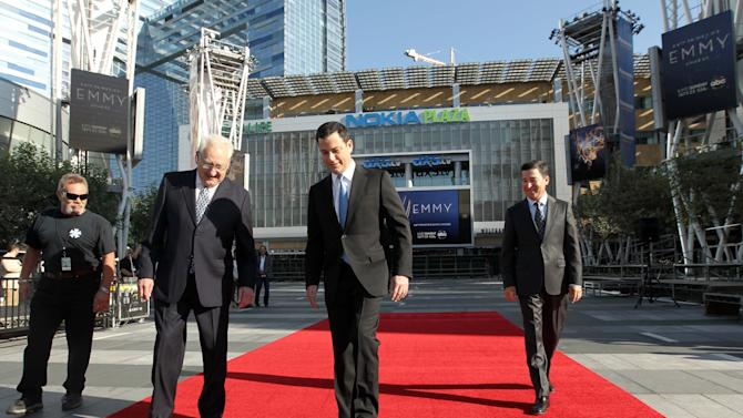 Don Mischer, executive producer of the 64thPrimetime Emmy Awards, left, hostJimmy Kimmel, center,and Television Academy chairman and chief executive Bruce Rosenblum attend the Emmy Awards Red Carpet Rollout at the Nokia Theatre on Wednesday, Sept. 19, 2012, in Los Angeles. The Emmy Awards will be held Sunday, Sept 23. (Photo by Matt Sayles/Invision/AP)