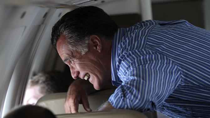 Republican presidential candidate, former Massachusetts Gov. Mitt Romney,  looks out the campaign charter airplane window during the flight between San Diego and Hayden, Co., Monday, May 28, 2012.  (AP Photo/Mary Altaffer)