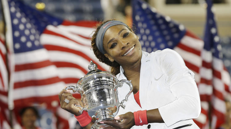 Serena Williams holds up the championship trophy after defeating Victoria Azarenka, of Belarus, during the women's singles final of the 2013 U.S. Open tennis tournament, Sunday, Sept. 8, 2013, in New York.(AP Photo/Darron Cummings)
