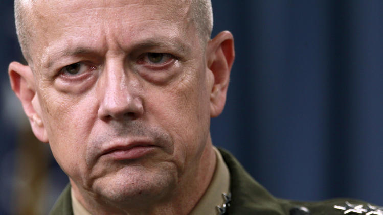 FILE- In this March 26, 2012, file photo, Marine Gen. John Allen, the top U.S. commander in Afghanistan listens during a news conference at the Pentagon in Washington. The Afghan government says it has reached a deal with the U.S. to govern controversial night raids by American forces. The Afghan Foreign Ministry says the memorandum of understanding on special operations will be signed later Sunday, April 8, 2012, by Defense Minister Gen. Abdul Rahim Wardak and the commander of U.S. forces, Gen. John Allen. (AP Photo/Haraz N. Ghanbari, File)