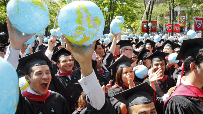 Malik Ahmad Jalal, of Rawalpindi, Pakistan, below right, celebrates with other Harvard University School of Government graduates during Harvard's 360th commencement exercises, on the school's campus, in Cambridge, Mass., Thursday, May 26, 2011. (AP Photo/Steven Senne)