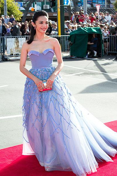 Chinese actress Yao Chen made an entrance with her dazzling lilac ballgown and metallic clutch. (Photo by Stephen Barker / Rex Features)