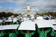 "Volunteers take part in flash mob to mark the 500-days before Sochi 2014 Winter Olympics at the VVTs (All Russian Exhibition Centre) a public park and exhibition space in Moscow, on September 25. Russia has unveiled the phrase ""Hot. Cool. Yours."" as the slogan for the Games as the 500-day countdown began"