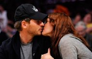 Actress Drew Barrymore (R) and Will Kopelman kiss during Game Two of the Western Conference Quarterfinals between the Los Angeles Lakers and the New Orleans Hornets in the 2011 NBA Playoffs in 2011 at Staples Center in Los Angeles, California. Barrymore married her art dealer beau at her Montecito, California home, the third trip down the aisle for the Hollywood star