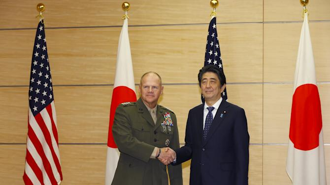 Gen. Robert B. Neller, Commandant of the Marine Corps, and Japanese Prime Minister Shinzo Abe pose for photographers prior to a meeting at Abe's official residence in Tokyo