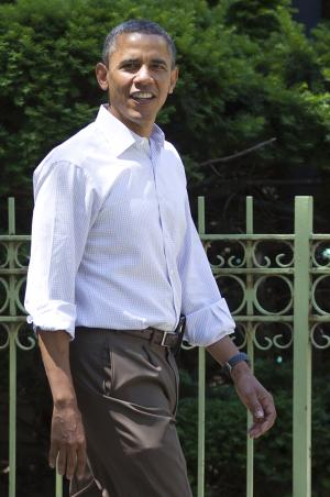 President Barack Obama walks through his Hyde Park neighborhood with senior advisor Valerie Jarrett to Marty Nesbitt's home, Saturday, June 2, 2012, in Chicago. (AP Photo/Carolyn Kaster)