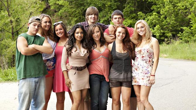 """FILE - This undated image originally released by MTV shows the cast of the new reality series """"Buckwild,"""" from left, Shain Gandee, Anna, Katie, Salwa, Joey, background center, Ashley, Tyler, background right, Cara and Shae. MTV said Wednesday, April 10, 2013, it is canceling its West Virginia-based reality TV show """"Buckwild"""" a week after the accidental death of 21-year-old star Shain Gandee. Network spokesman Jake Urbanski confirmed the news, saying it was """"not an easy decision."""" (AP Photo/MTV, file)"""