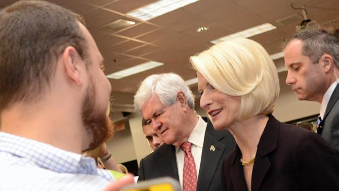 Republican presidential candidate and former House Speaker Newt Gingrich  and his wife Calista Gingrich shake hands with students after speaking at Louisiana College in Pineville, La., on Wednesday, March, 21, 2012. (AP Photo/The Daily Town Talk, Tia Owens-Powers)  NO SALES