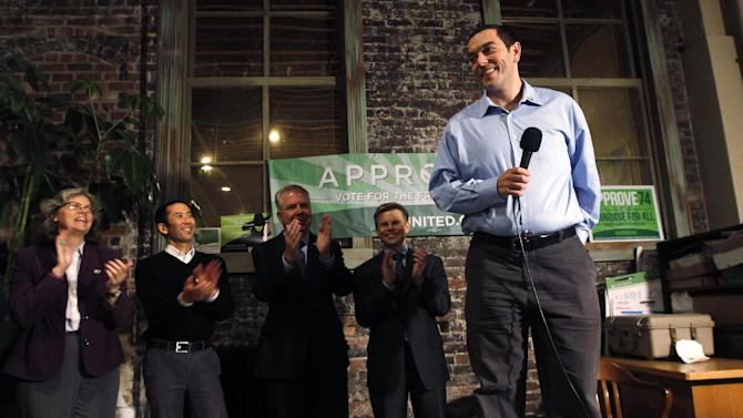 Zach Silk, campaign manager for Washington United for Marriage, is applauded as be begins to speak at a news conference by supporters of Referendum 74, which would uphold the state's new same-sex marriage law, Wednesday, Nov. 7, 2012, in Seattle. Supporters of gay marriage in Washington state declared victory Wednesday, saying they don't see a way for their opponents to prevail as votes continue to trickle in on Referendum 74. R-74 asked Washingtonians to approve or reject a state law legalizing same-sex marriage that lawmakers passed earlier this year. That law was signed by Gov. Chris Gregoire but has been on hold pending the election's outcome. With about half of the expected ballots counted Tuesday night, R-74 was passing with 52 percent of the vote. (AP Photo/Elaine Thompson)