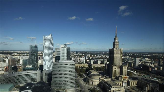 A general view of Warsaw city center and the Palace of Culture is seen through the window of a hotel in Warsaw