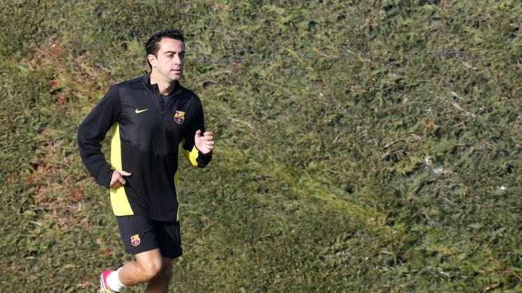 FC Barcelona's player Xavi Hernandez runs during a training session at Ciutat Esportiva Joan Gamper in Sant Joan Despi