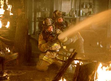 Joaquin Phoenix and John Travolta in Touchstone's Ladder 49