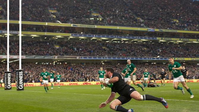 New Zealand's centre Ryan Crotty scores a try during the international rugby union test match between Ireland and New Zealand at Aviva Stadium in Dublin on November 24, 2013