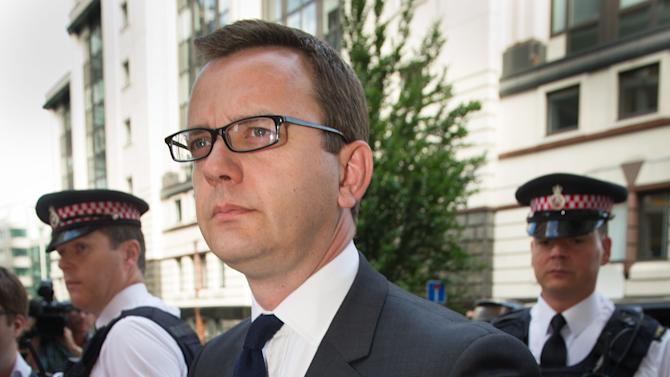 Former News of the World editor Andy Coulson arrives at the Old Bailey court to be sentenced, in London, Friday, July 4, 2014. Coulson, 46, has been found guilty of being involved in the conspiracy to hack into the phone voicemails of many celebrities, royals, politicians and ordinary members of the public, at the now-closed British Sunday tabloid newspaper. Coulson has been sentenced to 18 months in jail. (AP Photo/PA, Stefan Rousseau) UNITED KINGDOM OUT