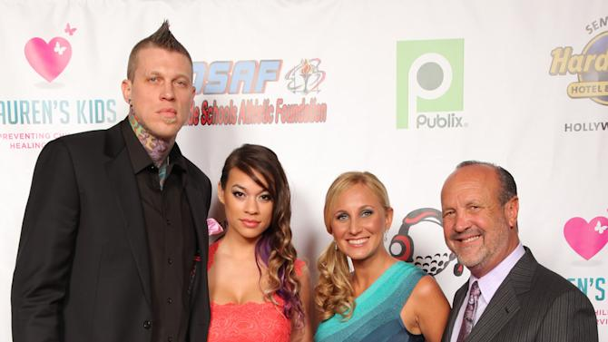 Miami HEAT Chris Andersen with guest Tina Wiseman pose with Lauren's Kids founder, Lauren Book and father Ron Book attend the Seventh Annual Reid & Fiorentino Call of the Game Dinner Presented by Publix at the Seminole Hard Rock Hotel & Casino on Saturday, March 9th, 2013 in Hollywood, Fl. Lauren's Kids is a Florida-based organization aimed at preventing child sexual abuse and healing survivors through education and awareness. The organization, headquartered in Aventura, Florida, was started by Lauren Book, M.S. Ed., a survivor of childhood sexual abuse who endured abuse at the hands of her nanny for six years. (Photo by Omar Vega/Invision for Lauren's Kids/AP Images)
