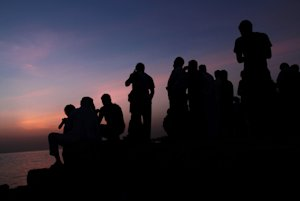 Bahraini men gather to search the sky over the Persian…