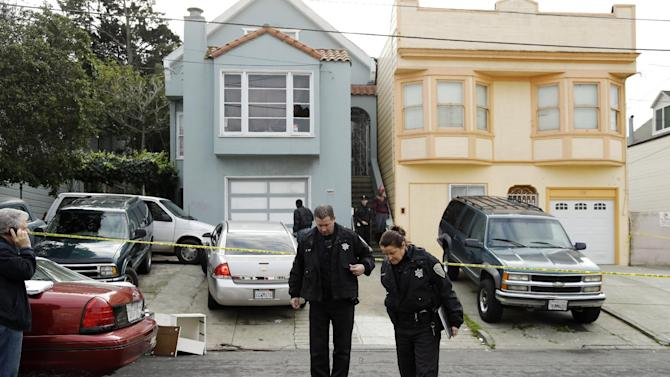 """San Francisco police officers search for evidence and guard the home of a woman who was set on fire Sunday, Jan. 6, 2013, in San Francisco. San Francisco police say a woman is hospitalized with what are being described as """"life-threatening injuries"""" after someone poured a flammable liquid on her and set her on fire. Police spokesman Officer Carlos Manfredi says officers were called to the city's Bayview District a little after noon by people who reported a woman screaming. When officers arrived they found a women suffering from what Manfredi described as """"severe burns."""" The woman, believed to be in her 20s, was taken to a hospital where she is being treated at a burn center. Her name has not been released. (AP Photo/Ben Margot)"""