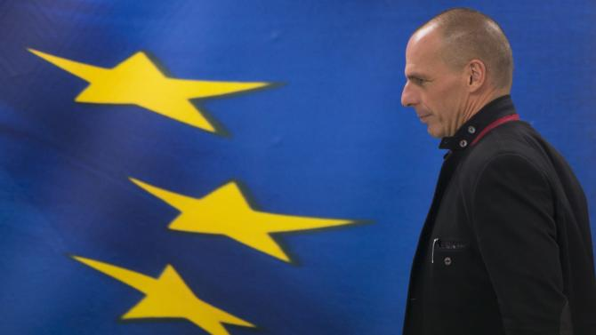 Newly appointed Greek finance minister Yanis Varoufakis arrives at a hand over ceremony in Athens