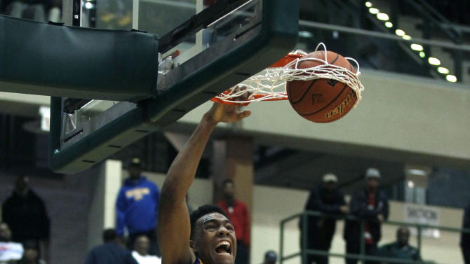 In this photo taken in Chicago, on Tuesday, March 13, 2012, Simeon's Jabari Parker dunks the ball during an Illinois state super sectional playoff basketball game against Evanston. (AP Photo/Charles Rex Arbogast)