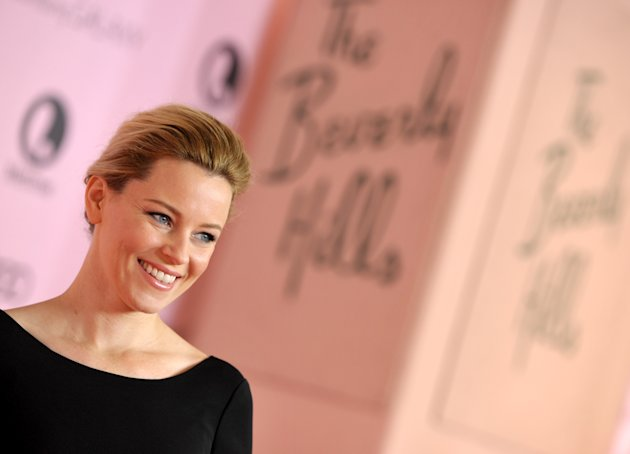IMAGE DISTRIBUTED FOR THE HOLLYWOOD REPORTER - Actress Elizabeth Banks arrives at The Hollywood Reporter's 21st Annual Women in Entertainment Power 100 breakfast presented by Lifetime on Wednesday, Dec. 5, 2012 in Beverly Hills, Calif. (Photo by John Shearer/Invision for The Hollywood Reporter/AP Images)