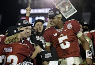 Florida State head coach Jimbo Fisher and Jameis Winston (5) celebrate the BCS National Championship win over Auburn. (AP)