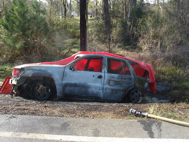 This March 6, 2012 photo provided by the law offices of Butler, Wooten & Fryhofer, LLP shows the scene of a crash in Bainbridge, Ga., where a 4-year-old boy named Remi Walden was burned and died when