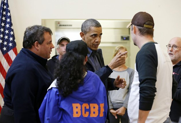 President Barack Obama, accompanied by New Jersey Gov. Chris Christie meets with local residents at the Brigantine Beach Community Center in Brigantine, NJ., Wednesday, Oct. 31, 2012. Obama traveled to Atlantic Coast to see first-hand the relief efforts after Superstorm Sandy damage the Atlantic Coast. (AP Photo/Pablo Martinez Monsivais)