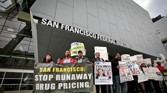 IMAGE DISTRIBUTED FOR AIDS HEALTHCARE FOUNDATION - Advocates from AIDS Healthcare Foundation and other groups protest in front of the new federal building on Thurs., Nov. 15, 2012 in San Francisco to protest the high price of drugs, particularly Gilead's AIDS drugs, after announcing the launch of a new ballot initiative in San Francisco to rein in drug prices.  (John Storey/AP Images for AIDS Healthcare Foundation)