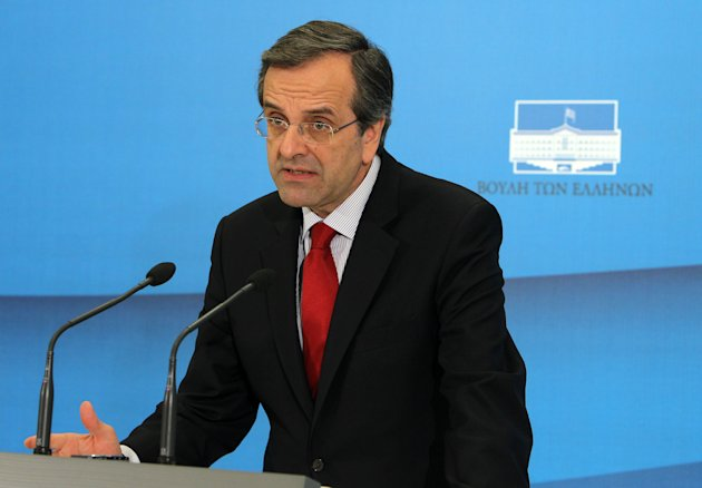Leader of Conservatives New Democracy party Antonis Samaras makes statements after his meeting with Greece's newly installed caretaker prime minister Panagiotis Pikramenos at the Greek Parliament in Athens, Monday, May 21, 2012. Greece is set to hold elections on June 17 to end a political deadlock after a previous vote on May 6 produced a hung Parliament, with the country's future in the 17-nation eurozone potentially at stake. (AP Photo/Thanassis Stavrakis)