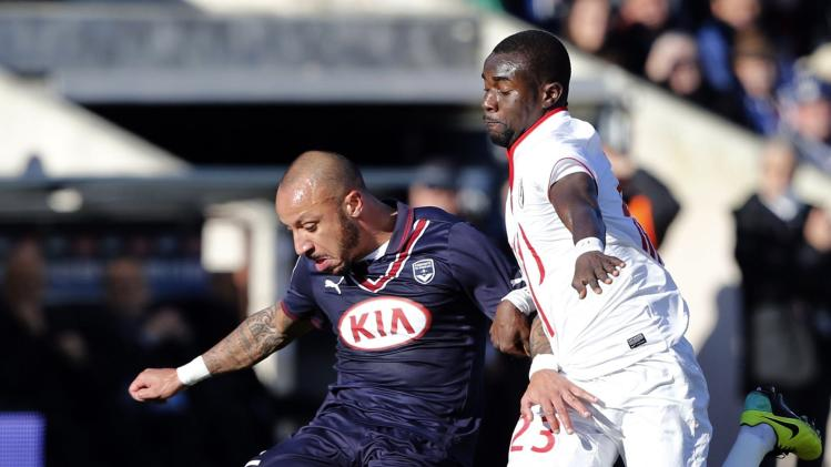 Julien Faubert of Girondins Bordeaux fights for the ball with Pape Ndiaye Souare of Lille during their French Ligue 1 soccer match at the Chaban Delmas Stadium in Bordeaux