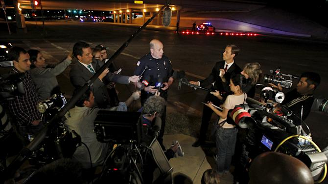 Police spokesman Joe Harn addresses the media after a shooting outside the Muhammad Art Exhibit and Contest in Garland, Texas