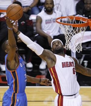 Miami Heat small forward LeBron James (6) shoots as Oklahoma City Thunder small forward Kevin Durant (35) defends during the first half at Game 3 of the NBA Finals basketball series, Sunday, June 17, 2012, in Miami. (AP Photo/Wilfredo Lee)
