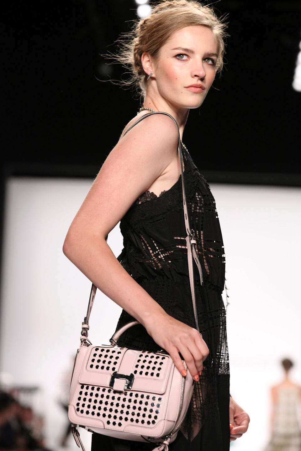 The Rebecca Minkoff Spring Summer 2014 collection is modeled at New York Fashion Week on Friday, Sept. 6, 2013. (AP Photo/Lisa Tolin)